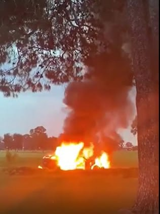 A Holden sedan erupts in flames in the parklands near Adelaide's old Victoria Park racecourse. Picture: Jane Reilly, FIVEaa