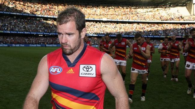 Mark Ricciuto leads the Crows from the field after his last game for Adelaide, a loss to Hawthorn in an elimination final in 2007.