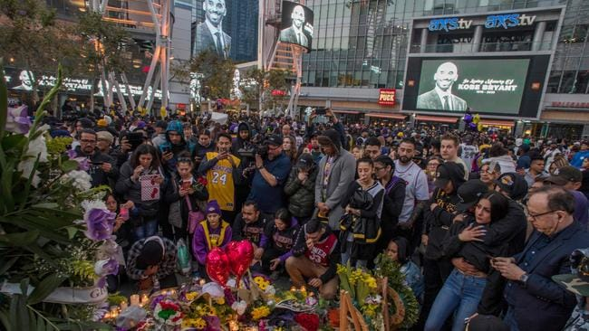 People gathered around a makeshift memorial for Bryant in front of Staples Center in Los Angeles on Sunday night. Picture: AFP/Apu Gomes