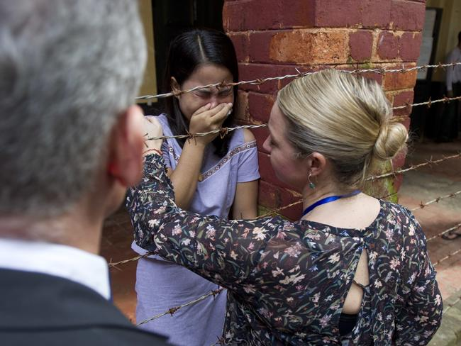 Chit Su Win, wife of Kyaw Soe Oo, is comforted by a Reuters official. Picture AP