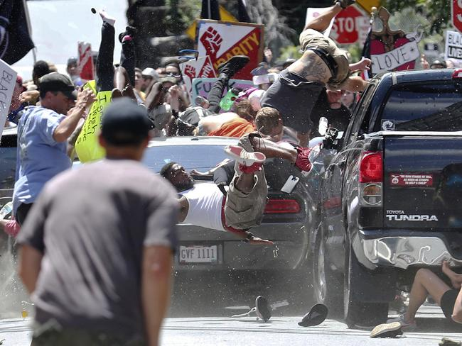 People fly into the air as a vehicle drives into a group of protesters demonstrating against a white nationalist rally in Charlottesville. Picture: Ryan M. Kelly/The Daily Progress/AP