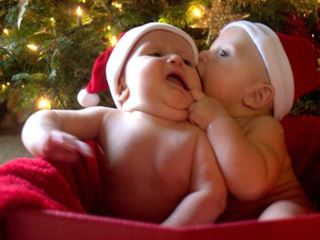 """Our twin babies misbehaving during a Christmas photo shoot abroad."""
