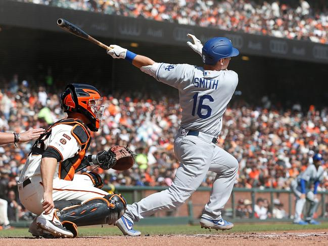 Will Smith #16 of the Los Angeles Dodgers hits a two-run home run in the top of the first inning against the San Francisco Giants at Oracle Park in San Francisco. Picture: Lachlan Cunningham/Getty Images