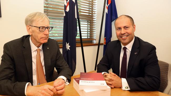"""Commissioner Kenneth Hayne handed the final report to Treasurer Josh Frydenberg (right) on Friday, making for an awkward photo. When photographers asked, """"Could we get a handshake or something …"""" Mr Hayne stonily replied, """"nope."""" Picture: AAP Image/Fairfax Media Pool, Kym Smith"""