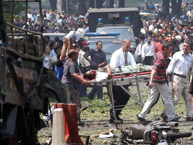 Recurring threat ... a victim is evacuated in front of the Australian Embassy following an explosion in Jakarta, Indonesia. Picture: Achmad Ibrahim / AP Photo