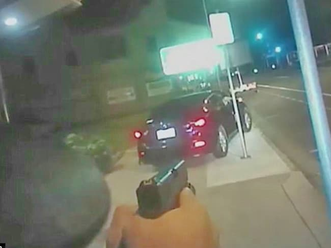 Police aimed their gun at the man in the car in an attempt to get him to stop driving. Picture: Queensland Police Service