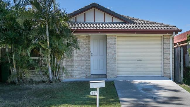 This four-bedroom house at 10 Starling St, Loganlea, is on the market for just $339,000.