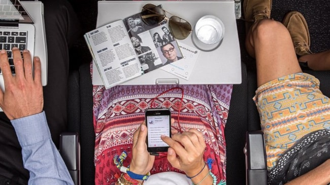 The woman showed no interested in looking up from her phone and her book. Source: Instagram/airnz