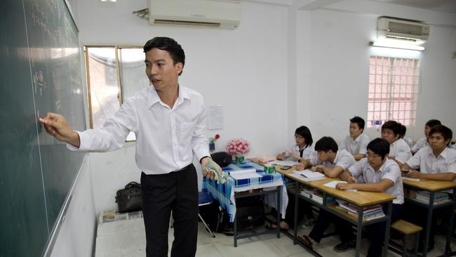 Tran Van Giap teaching his Year 12 maths class at Truong Thpt school in Ho Chi Minh in 2012. Picture: Michael Amendolia