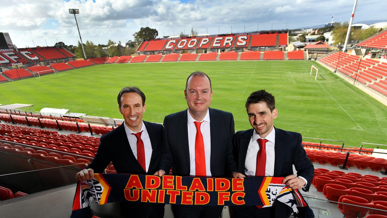 Adelaide United chairman Piet van der Pol poses for a photograph with Aurelio Vidmar (left) and Nathan Kosmina (right) at Coopers Stadiium