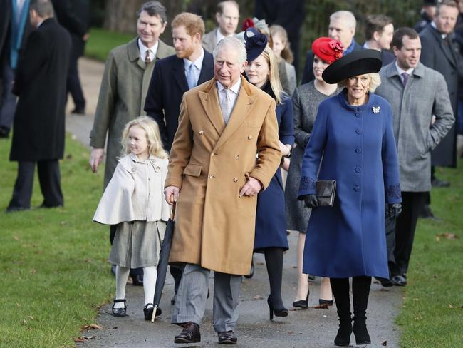 prince charles and camilla the duchess of cornwall lead other members of the royal family into church at sandringham last christmas day