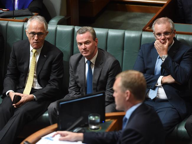 Prime Minister Malcolm Turnbull, Defence Industries Minister Christopher Pyne and Treasurer Scott Morrison look at Speaker Tony Smith after the government lost two divisions in the House of Representatives. Picture: AAP Image/Mick Tsikas