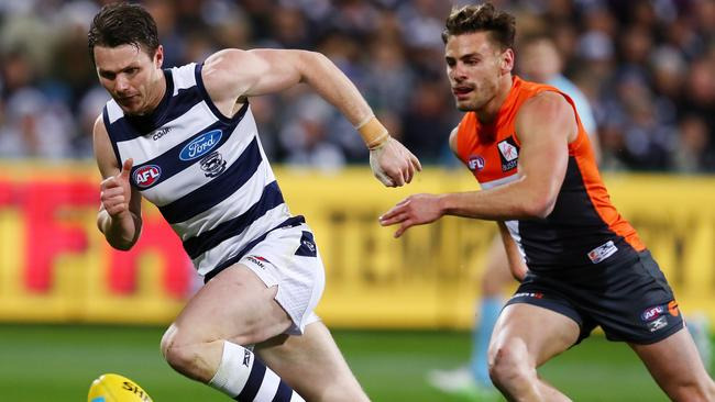 Patrick Dangerfield is pursued by Stephen Coniglio. Picture: Michael Klein