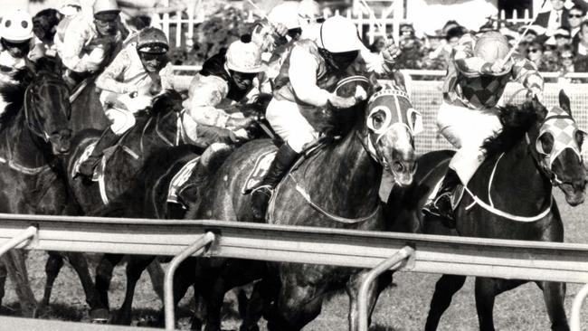 Victorian grey Plush Embassy holds off Ark Regal to win the 1990 Stradbroke Handicap. Picture: Barry Pascoe