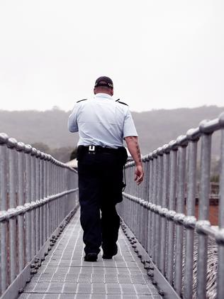 Senior correctional officer watches inmates from above at Goulburn. Picture: Sam Ruttyn