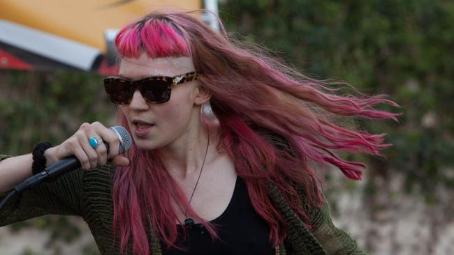Grimes in sunnies — possibly after having her eyeball film removed???