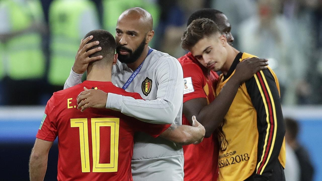 Belgium assistant coach Thierry Henry consoles Eden Hazard at the end of the semifinal.