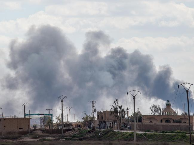 Smoke billows after shelling on the ISIS group's last holdout of Baghouz, in eastern Syria. Picture: AFP