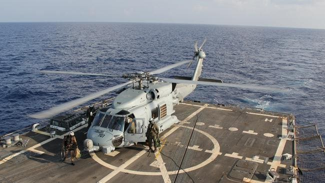 U.S. Navy MH-60R Sea Hawk helicopter during a crew swap in MH370 search. Picture: Getty Images