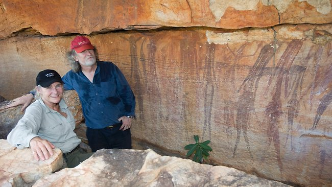 Researchers survey excavation sites of Gwion rock art in the north Kimberley. A sheer rock face is protected by a shallow overhang leaving a perfectly preserved Bradshaw or Gwion painting depicting unusually large figures.