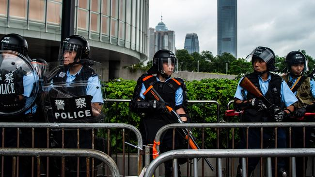Riot police stand guard outside the Legislative Council. Picture: Philip Fong/AFP
