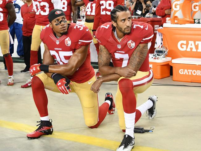 Eric Reid and Colin Kaepernick kneel during the national anthem.