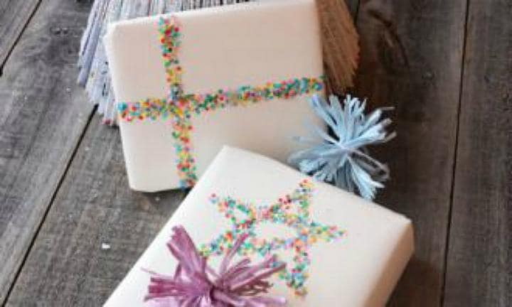"<b>CONFETTI WRAPPING:</b> Don't want to spend too many $$$ on wrapping paper, but still want your gifts to look fun and festive? Why not try this fun confetti hack?  <a href=""http://www.kidspot.com.au/things-to-do/activities/confetti-ribbon-gift-wrap"">Get the instructions here</a>"