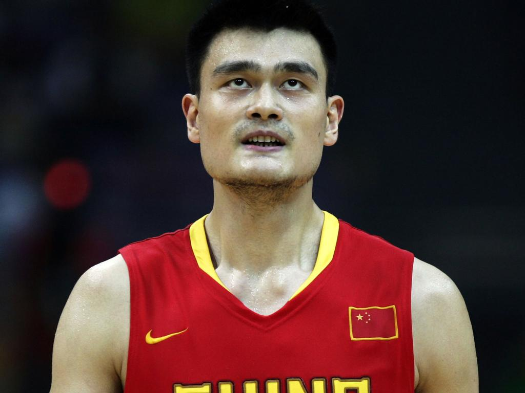 Chinese center Yao Ming reacts after loosing a point to Australia during a warm up game for next month's Olympics at the Diamond Ball tournament in Nanjing, China, Wednesday, July, 30, 2008. China found itself hard pressed by the very physical Australian team lead by the Milwaukee Bucks Andrew Bogut. China lost the game 67-55. (AP Photo/ Elizabeth Dalziel)