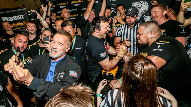 Arnold Schwarzenegger takes a selfie as he mingles at today's event. Picture: Tim Carrafa