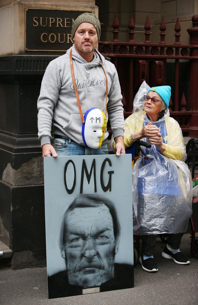 A protester outside the Supreme Court of Victoria today. Picture: Michael Dodge/Getty Images