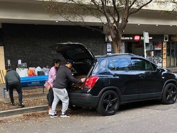 Residents pack the boot of a car after being given a short window to gather their belongings. Picture: Phoebe Loomes