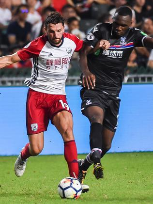 Jay Rodriguez of West Bromwich Albion (L) fights for the ball with Christian Benteke (R).