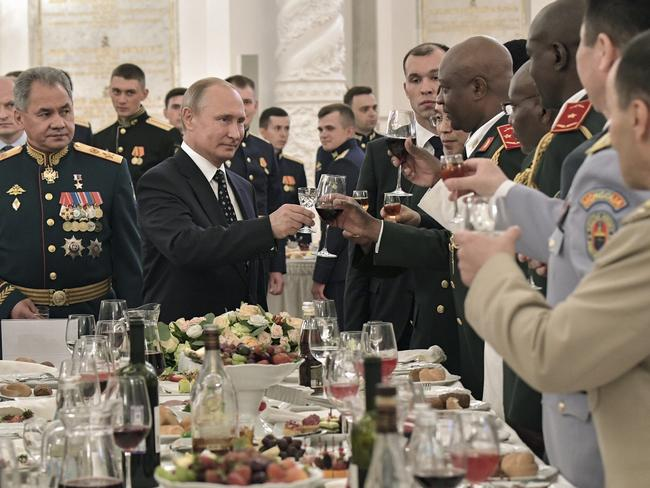Russian President Vladimir Putin, centre, toasts with the graduates of Russian military academies in the Kremlin in Moscow, Russia, Thursday, June 28, 2018. Picture: Alexei Nikolsky