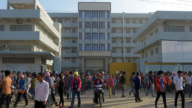 Cambodian workers leaving a factory in Phnom Penh. Picture: AFP