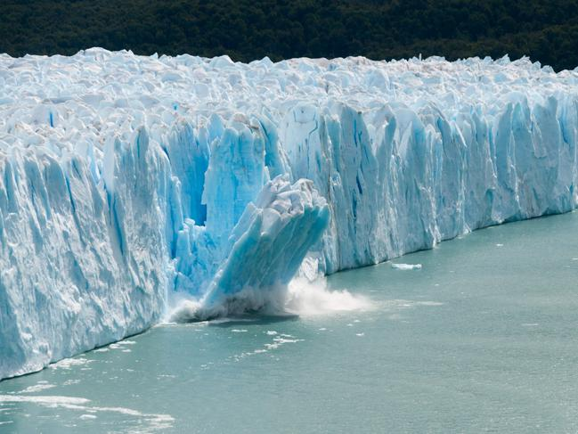 A giant piece of ice breaks off the Perito Moreno Glacier in Patagonia, Argentina.
