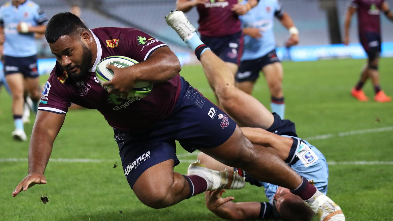 Taniela Tupou of the Reds breaks the tackle. (Photo by Mark Kolbe/Getty Images)