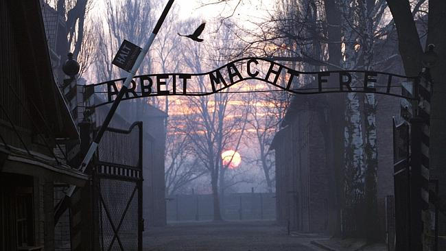The entrance to Auschwitz concentration camp in Poland in 1945. The sign says 'Work makes one free'.