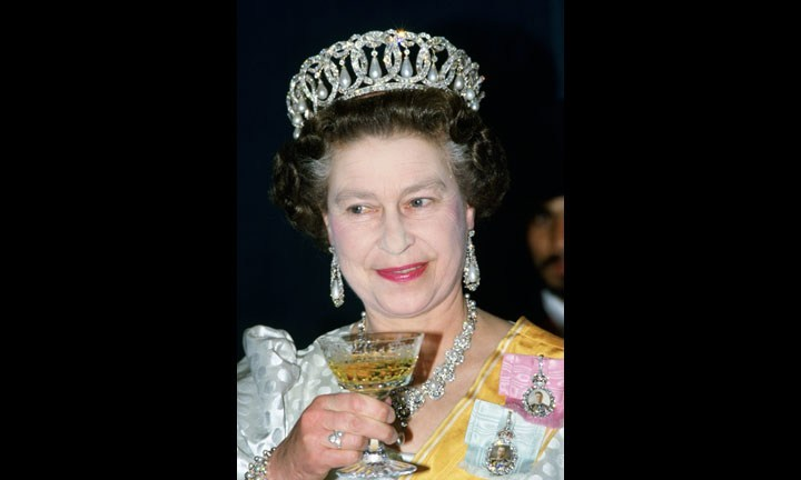 NEPAL - FEBRUARY 19: Queen Elizabeth II drinks champagne at a State Banquet in Nepal (Photo by Tim Graham/Getty Images)