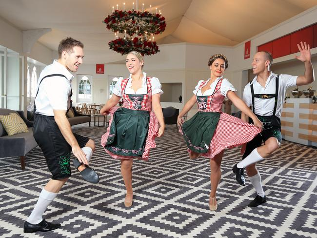 Mixing business with leader ... Nick Phillips, Britt Battams, Tayla Lemon and Reid Monks with the German Slap Dancers at the Emirates Marquee. Picture: Alex Coppel