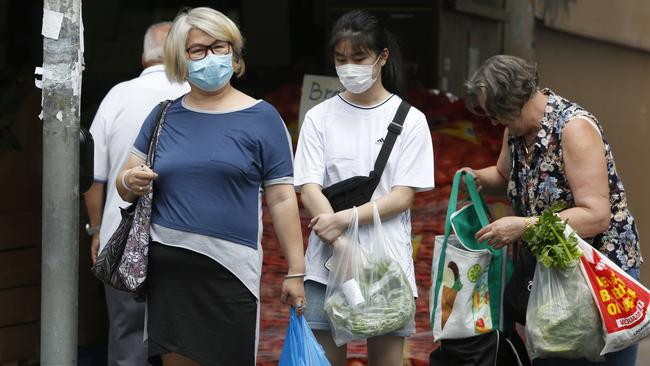 People wearing masks on a street in Campsie, Sydney. Picture: Robert Pozo/AAP