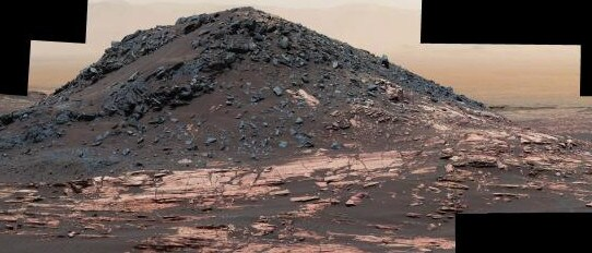 This dark mound is called Ireson Hill, and rises around 4.8m in the air on lower Mount Sharp. This photo is made up of 41 images taken by the Curiosity rover in February 2017. Picture: NASA