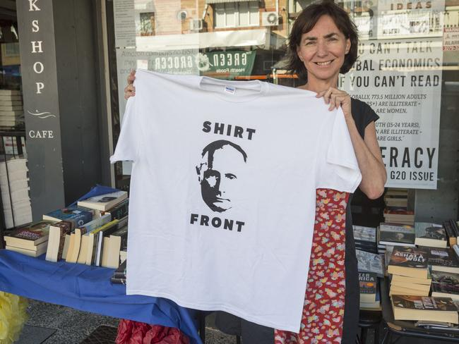 Putin the talk of the city ... Fiona Stager, owner of Avid Reader Bookstore, Brisbane, shows off a President Putin Shirt Front T-shirt. Picture: Glenn Hunt / Getty Images