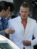 <p>2003: British soccer player &amp; new Real Madrid player David Beckham (R) listens to an unidentified official of the soccer club as he arrives at the Zarzuela Hospital of Madrid for a medical check-up.</p>