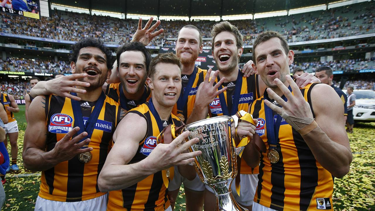 Jordan Lewis (second from left) won four premierships with Hawthorn. Photo: Wayne Ludbey.