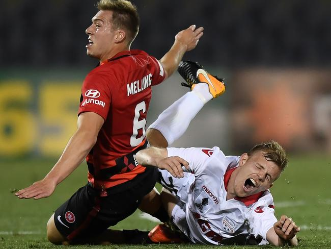 Adelaide's Jordan Elsey (right) is crunched by Western Sydney's Jacob Melling in their FFA Cup semi-final.