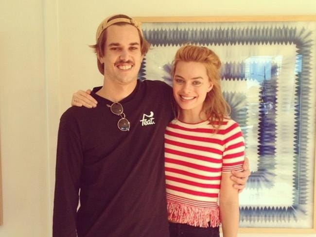 Margot Robbie and local artist Nicholas Chalmers during her fleeting visit to the Gold Coast.