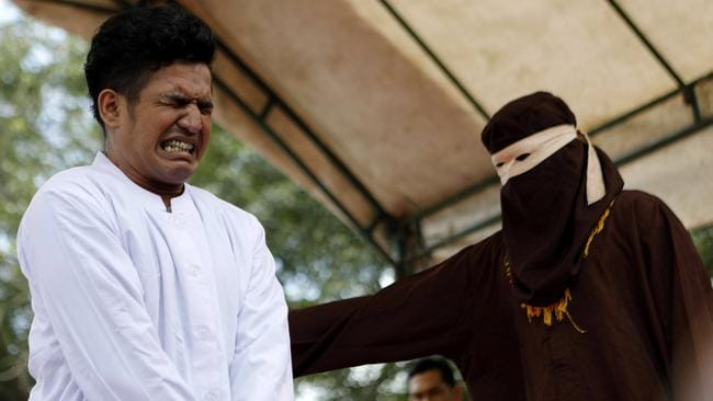 An Acehnese man is whipped in front of the public for violating sharia law in Banda Aceh, Indonesia, 27 February 2017. His crime was having sex without being married. Picture: EPA / Hotli Simanjuntak
