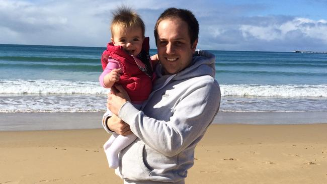 Beach baby ... Jeremy and Annabelle White on holidays at Noosa Main Beach. Picture: Supplied.