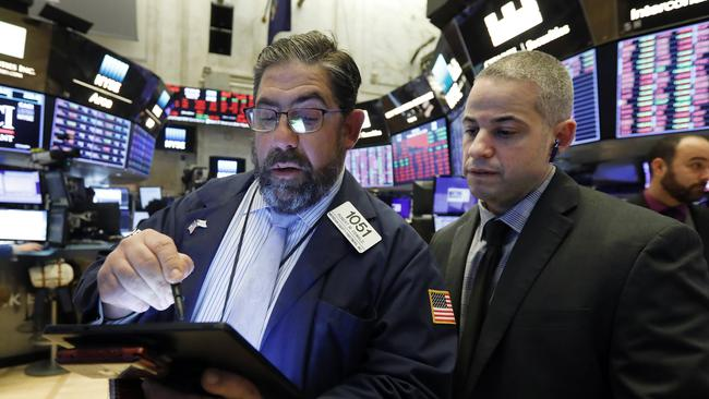 Director of Trading Floor Operations Fernando Munoz, right, works with trader Robert Oswald, on the floor of the New York Stock Exchange, Wednesday, March 11, 2020. Picture: AP Photo/Richard Drew.