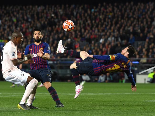 Lionel Messi attempts a overhead kick at Camp Nou. (Photo by David Ramos/Getty Images)